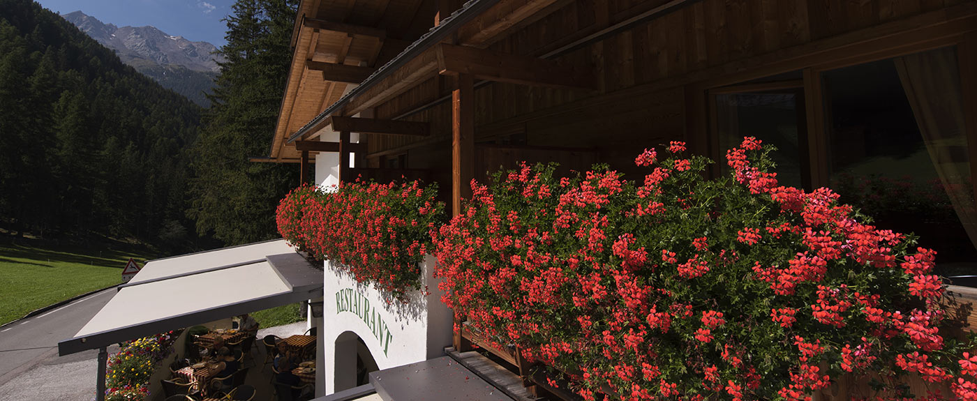 Beautiful geraniums on the balconies of Hotel Arnstein