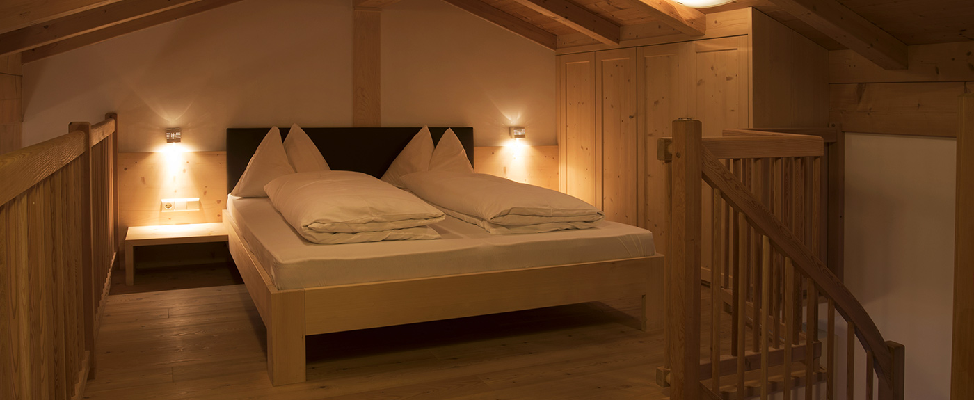Double bed on a mezzanine at im Hotel Arnstein